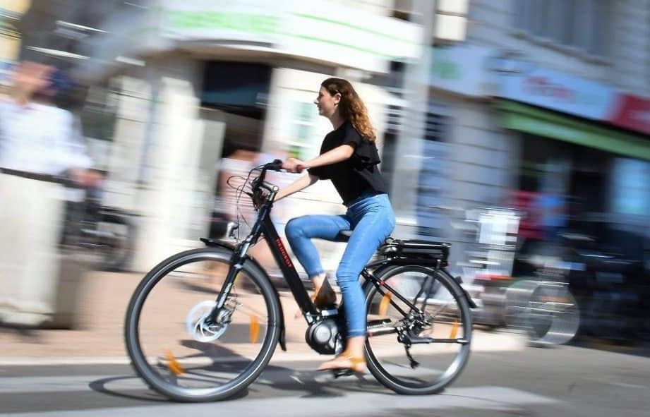 Easy E-Biking - woman riding city e-bike, helping to make electric biking practical and fun