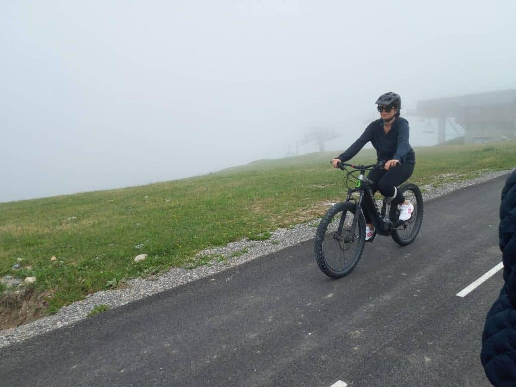 Easy E-Biking - woman e-bike mountain road, helping to make electric biking practical and fun