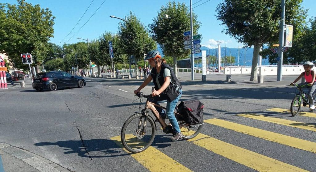 Easy E-Biking - woman riding e-bike city, helping to make electric biking practical and fun