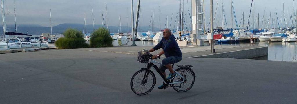 Easy E-Biking - man riding e-bike lake, helping to make electric biking practical and fun