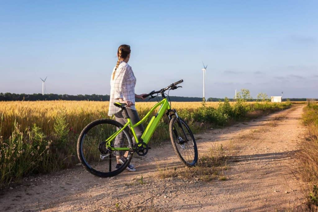 Easy E-Biking - woman e-bike city nature, helping to make electric biking practical and fun
