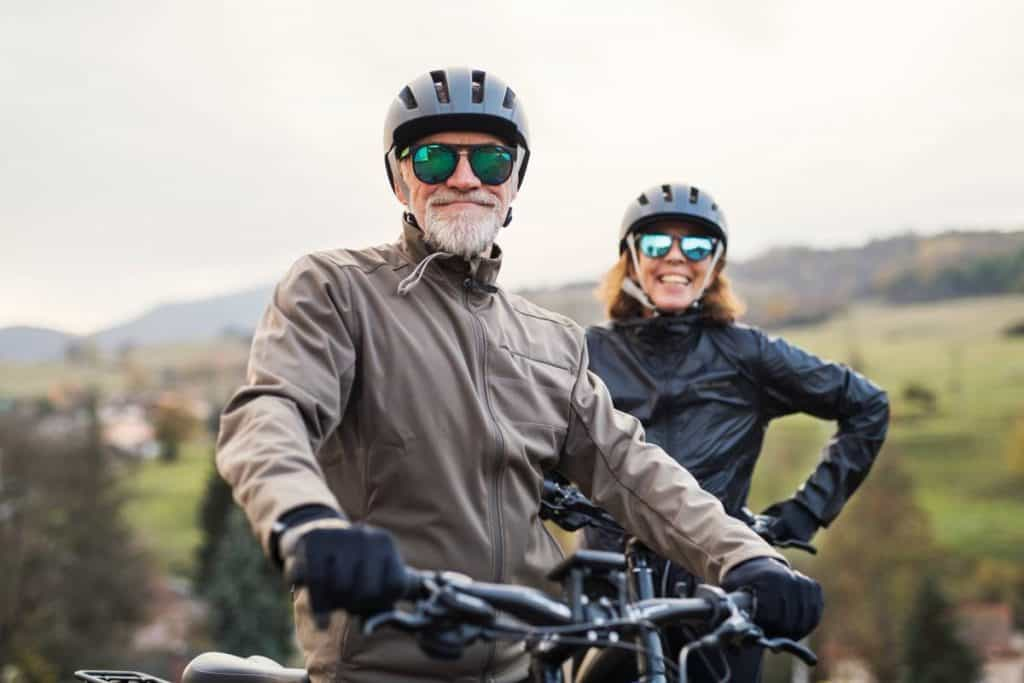 Easy E-Biking - senior couple riding e-bikes, helping to make electric biking practical and fun